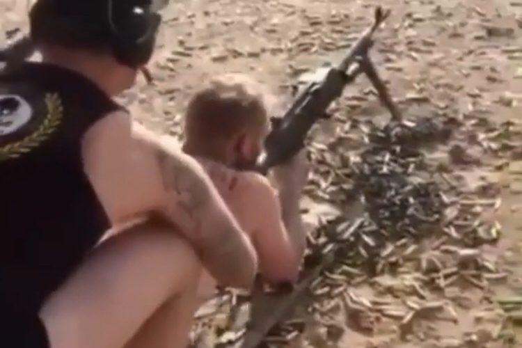 man shoots gun naked