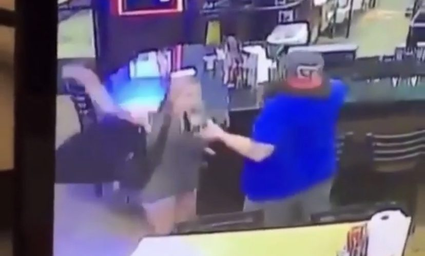 Unbothered man knocks woman out in bar