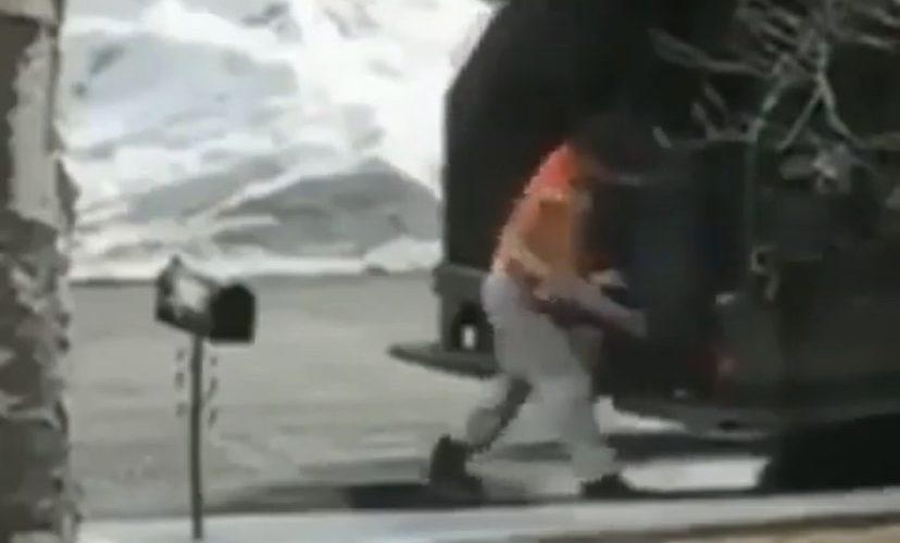 angry trash man breaks mailbox
