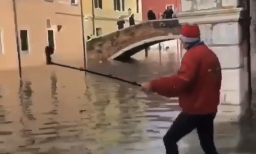 tourist falls in floodwater