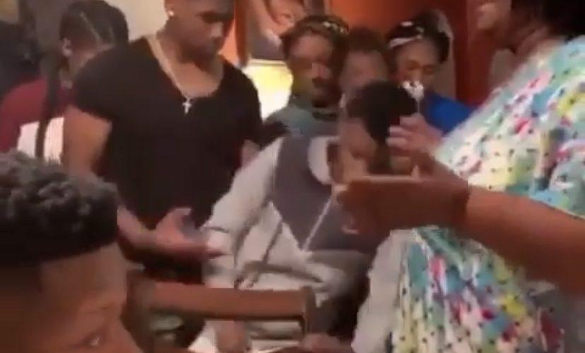 boy falls out during grandma's Thanksgiving prayer