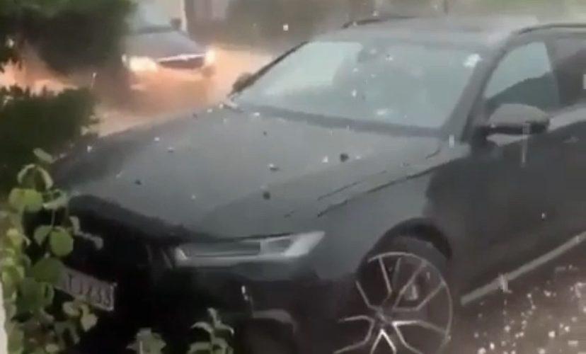 Hailstorm destroys car
