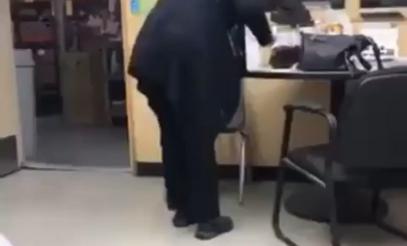 woman caught in office licking cake