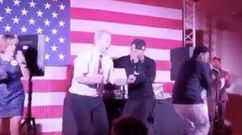 Presidential candidate Tom Steyer performs with rapper Juvenile