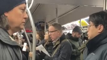 woman hanging from subway ride
