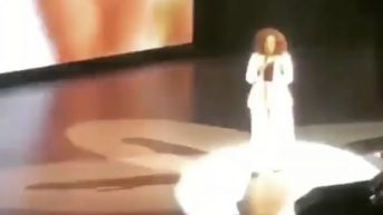 Oprah trips and falls while speaking