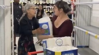 Women argue over the last pack of tissue in a store