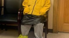 Woman with trash bag on body to avoid coronavirus