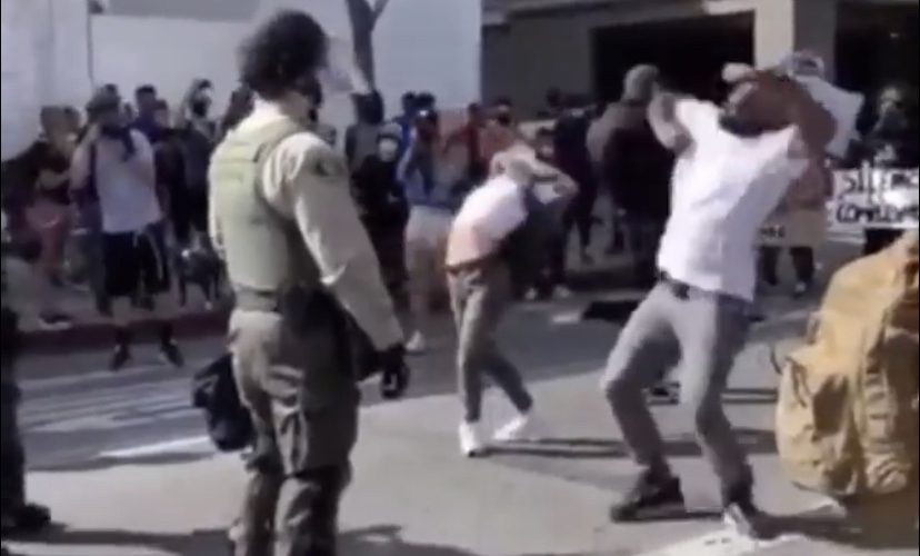 Man krumps in front of police