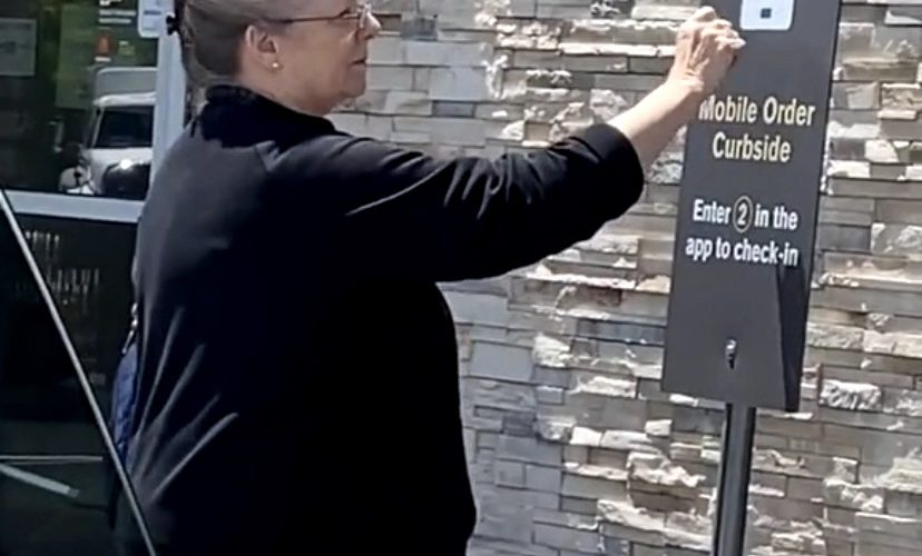 woman tries to order on Mcdonald's sign