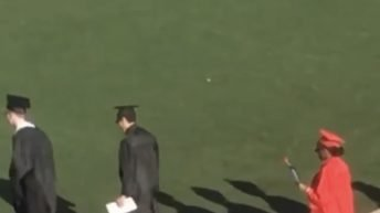 Girl wears heels during graduation