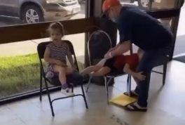 Man disciplines children in public