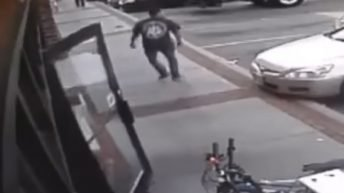 Car narrowly misses walking man