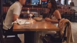Angry girlfriend throws food at boyfriend