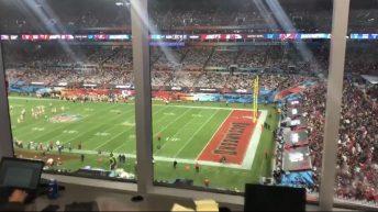 Super Bowl fan runs through the field