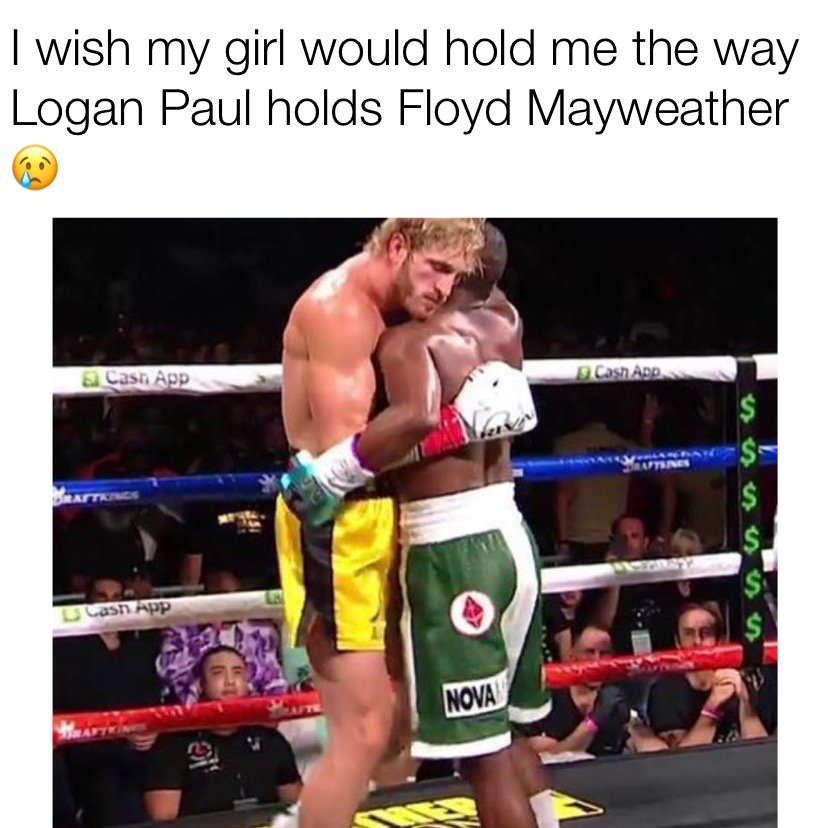 I wish my girl would hold me the way Logan Paul holds Floyd Mayweather meme