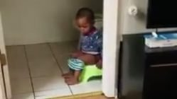 Toddler pees in floor while using potty chair