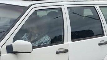 Old woman blocks highway lane