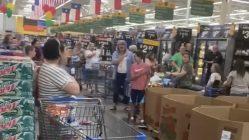 Walmart customers sing the National Anthem
