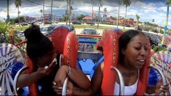 Woman loses wig on sling shot ride