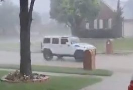Woman gets caught in rain with Jeep top down