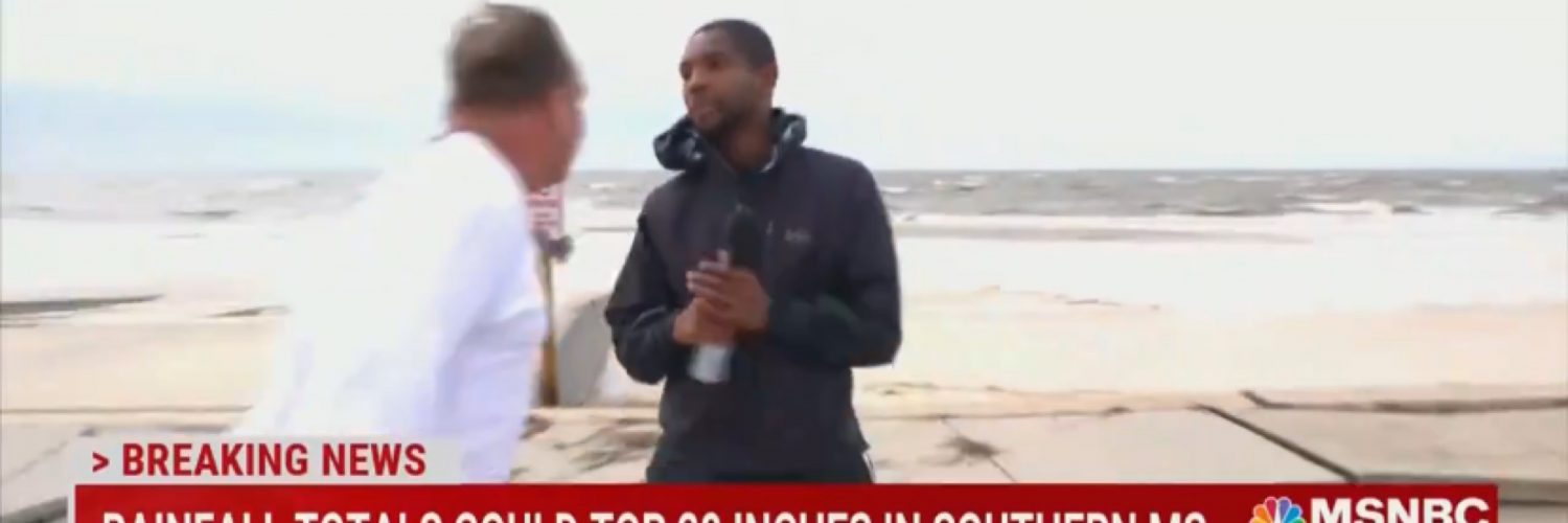 Reporter Shaquille Brewster heckled by crazy man
