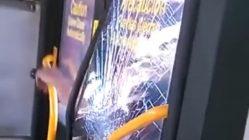 Angry man breaks through bus window