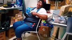 Woman cracks up at TikTok on lunch break